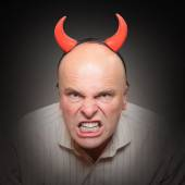 Angry man with devil horns. — Stock Photo
