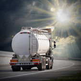 White tanker truck on the highway. — Stock Photo