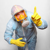 Man in protective clothing with respirator. — Stock Photo