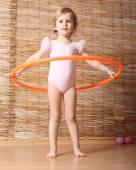 Little girl holding hula hoop. — Stock Photo
