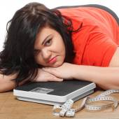 Overweight woman with measure tape and weighing machine — Stock Photo