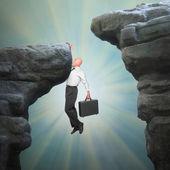 Senior businessman on a edge of cliff — Stock Photo