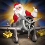 Santa Claus with his cargo plane — Stock Photo #66002081