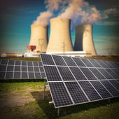 Solar panels against nuclear power plant. — Stock Photo