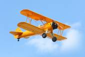 Biplane on the blue sky. — Stock Photo