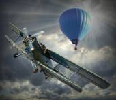 Biplane and hot air balloon. — Stock Photo