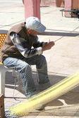 Old Fisherman mending his nets  at Tasucu Port — Stock Photo