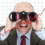 Man looking through binoculars — Stock Photo #55623029