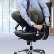 Scared businessman on office chair — Stock Photo #61860605