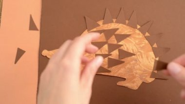 Stuck bristle of a hedgehog of paper on the body — Stock Video