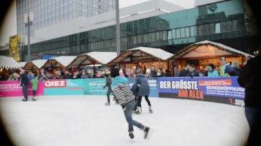 People ice skating on Xmas fair at Berlin Alexanderplatz — Stock Video