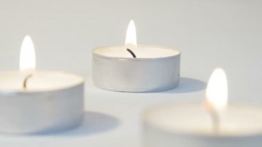Group of tea light candles — Stock Video
