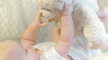 Little baby is playing with teddy bear — Stock Video