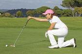 Beautiful senior female golf player — Stock Photo