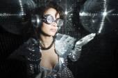 Sexy disco dancer in solver costume — Stock Photo
