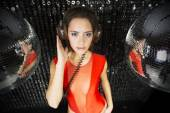 Beautiful sexy disco dj woman in lingerie surrounded by discobal — Stock Photo