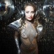 Постер, плакат: Sexy disco dancer in silver costume