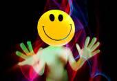 Sexy acid smiley rave dancer — Stock Photo