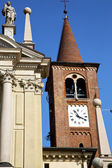 Busto   wall  and church tower   sunny day  — Foto de Stock