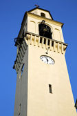 Olgiate    wall  and church tower bell sunny day  — Foto Stock