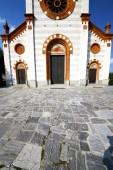 church  in  the mercallo  old   closed brick  sidewalk italy  l — Stockfoto