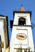 Travedona monate    the   wall  and church tower bell sunny day  — Stock Photo