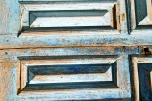 Dirty  paint   the blue  door  rusty nail — Stock Photo