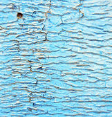 Dirty stripped paint in the blue wood door and rusty nail — Stock Photo