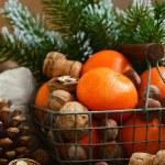 Xmas decoration wih tangerines, nuts and pine tree twigs — Stock Photo #60207063