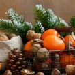 Xmas decoration with tangerines and nuts with copyspace on woode — Stock Photo #60207065