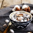 Salty apricot pits in oriental ceramic pattern bowl — Stock Photo #67780757
