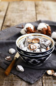 Salty apricot pits in oriental ceramic pattern bowl — 图库照片