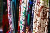 Silk shawls hanging at street market — Stock Photo