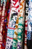 Silk shawls hanging at street bazaar — Stock Photo