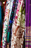 Silk shawls hanging at the market — Stock Photo