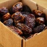 Dried dates in cardboard box — Stock Photo #70107037
