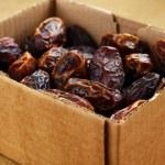 Dried dates in cardboard box — Stock Photo #70107881