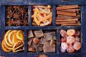 Set of chocolate, sugared oranges and spices — Stock Photo