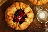 Homemade open pies or galette with apples and berry mix — ストック写真