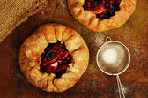 Homemade open pies or galette with apples and berry mix — 图库照片