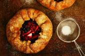 Homemade crusty pies or galette with apples and berries topped w — 图库照片