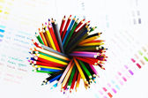 Multicolored wooden pencils and color palette — Stock Photo