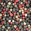 Red, black, green and white peppercorns — Stock Photo #56156245