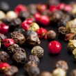 Red, black, green and white peppercorns — Stock Photo #60605901