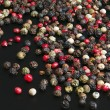 Red, black, green and white peppercorns — Stock Photo #60605919