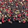 Red, black, green and white peppercorns — Stock Photo #61422665