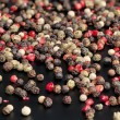 Red, black, green and white peppercorns — Stock Photo #64601193