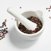 Peppercorns in a mortar — Stock Photo