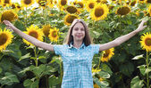 Beautiful girl with sunflower — Stock Photo