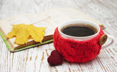 Knitted cup of coffee — Stock Photo